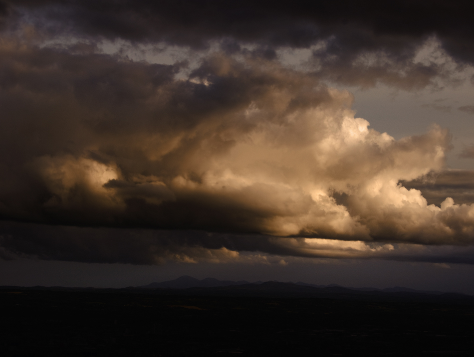 Mourne Mountains under Turneresque sky from the Cavehill, Belfast photo icon.