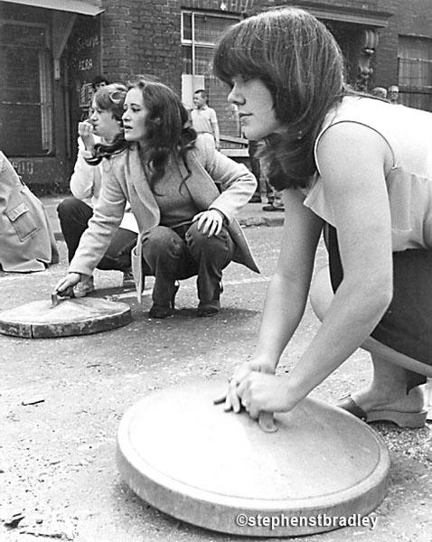 Women banging bin lids, Falls Road, Belfast, Northern Ireland, by Stephen S T Bradley, editorial, commercial, PR and advertising photographer, Dublin, Ireland